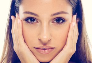 beautiful woman face studio natural portrait with healthy skin